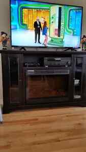 TV STAND WITH FIREPLACE IN EXCELLENT CONDITION
