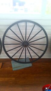 TWO GENUINE 100 YEAR OLD WAGON WHEELS