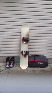 156 Salomon snowboard and bag. Rossignol boots