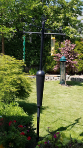 Bird feeder pole system with squirrel and raccoon proof baffle