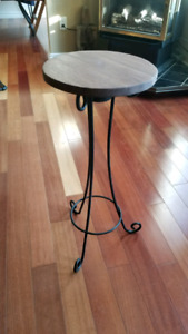Round walnut table with steel legs