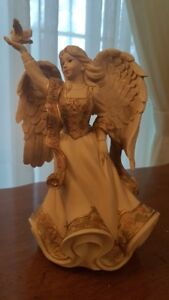 Sarah's Angel with Dove  MUSICAL collectible $30