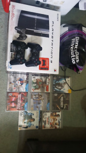 Ps3 in excellent condition with 2 controllers and lots of games