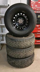 Nokian Hakkapeliitta R2 tires on Toyota 6 lug rims. 265/70R17