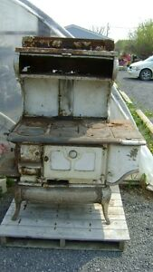 MULTIPLE VINTAGE ANTIQUE WOOD BURNING AND COAL STOVES $200 EACH