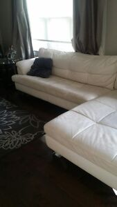 White leather sectional with matching chair