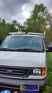 2005 Ford E-250 Vans. Two for one deal.
