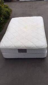 double size base with mattress.   comfortable. thtere is rip at t
