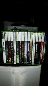 Black xbox 360 with 12 games