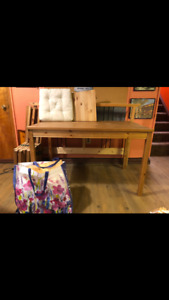 IKEA wood table with 4 matching chairs and chair cushions