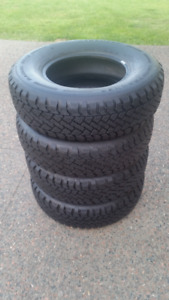 4 PACEMARK SNOWTRACKER 235/75R/15 WINTER TIRES IN GOOD CONDITION