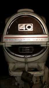 60`s Evinrude 40hp 2str s shaft outboard motor with control