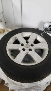 Like new Nissan WHEELS and TOYO WINTER TIRES 205/65 16