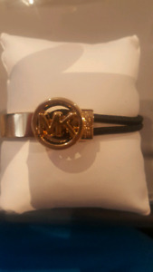 Michael Kors Gold plated and black bracelet