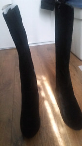 Ladies boots for $50 brand new.