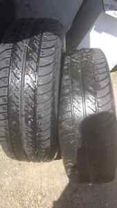 2 ALL SEASON TIRES ON RIMS FOR SALE