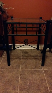 small glass table with black metal bottom