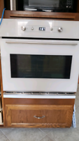 In-wall oven, countertop stove Whirlpl dishwasher Samsung fridge