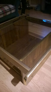 2 glass top pressed wood coffee tables