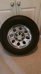 Four 17 inch Chevy Rims and Snow Tires