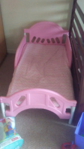 Pink Toddler bed with mattress.