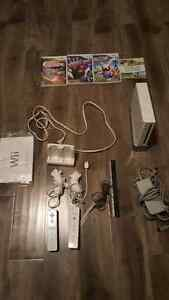 Nintendo wii console+ 2 sets controllers+4 games