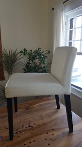 4 White leather chairs for sale $15 each