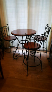 Wrought iron and wood bistro set