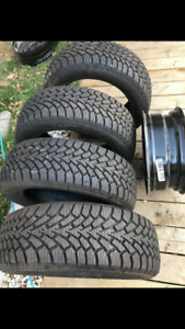 Set of 4 Good year studable winter tires + 4 rims and hubcaps