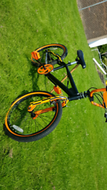 ORANGE and BLACK BMX. Only issue is brake sticking as I am not a bike