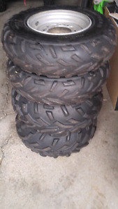 Tires on rims for a quad
