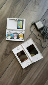 Nintendo DS Lite with games, charger and case