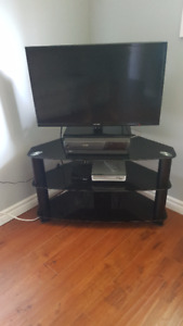 TV and Stand. with warranty till end of october