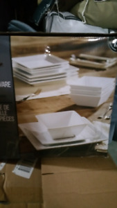 Brand new modern plates in the box