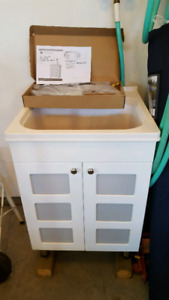 NEW.. Laundry room vanity with sink + tap
