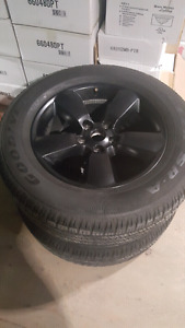 """Black 20"""" inch ram 1500 wheels and like new tires"""