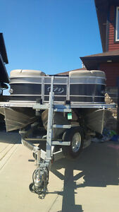 Immaculate pontoon boat with low hours for sale