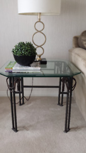 Two beautiful identical glass and metal side tables for sale