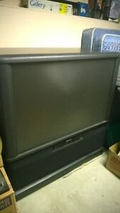 "60"" Projection TV with wheels on the bottom"