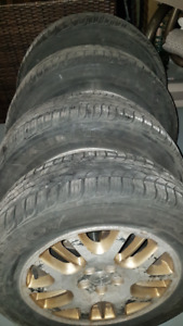 Four 215 60r16 all-season tires on mags, 8/32, excelent shape
