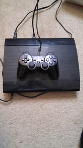 Play station super slim with 9 games.