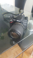 Nikon D5100 + 18-105mm lens + camera bag + 32GB memory card