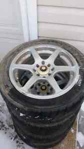 4 like new Rims and tires universal 4 lug