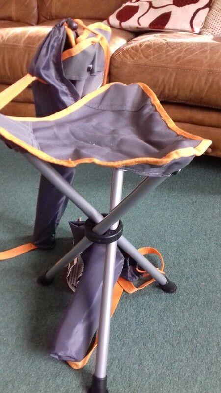 Grey and orange foldable tripod stools