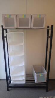 solid IKEA clothes rack with clothes storage containers