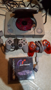 Original Playstation w/ 2 controllers and games