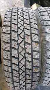 4 -185 64 14 studded snow tires 1/2 or a little better tread $80