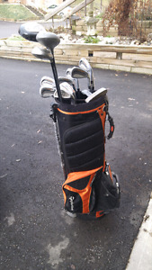 Right handed golf clubs with bag.