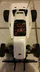 ACOMS racing car works good comes with remote and two batteries West Island Greater Montréal image 2