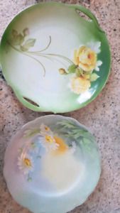 Antique porcelain plates with signature on the back